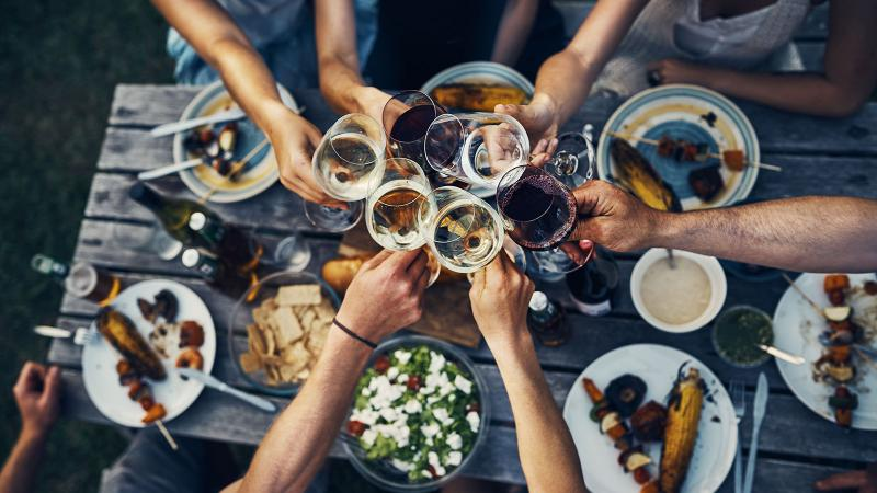 Drinking wine with a meal can produce some notable health benefits.
