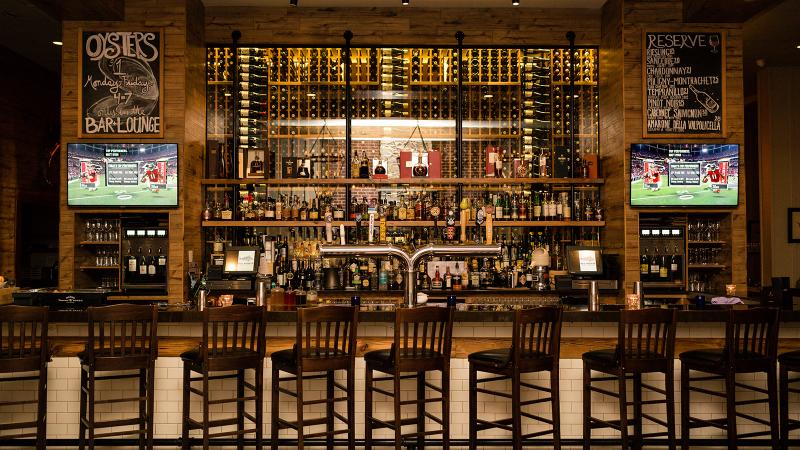 Blu Pointe's 6,300-bottle inventory helps decorate the dining room.