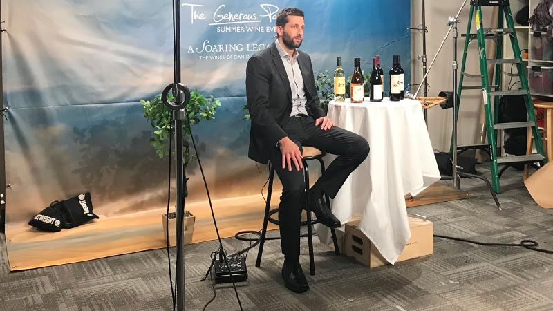 For four hours, Brian Phillips sits for a marathon of TV and radio appearances explaining and promoting the Capital Grille's Generous Pour wine-pairing special.