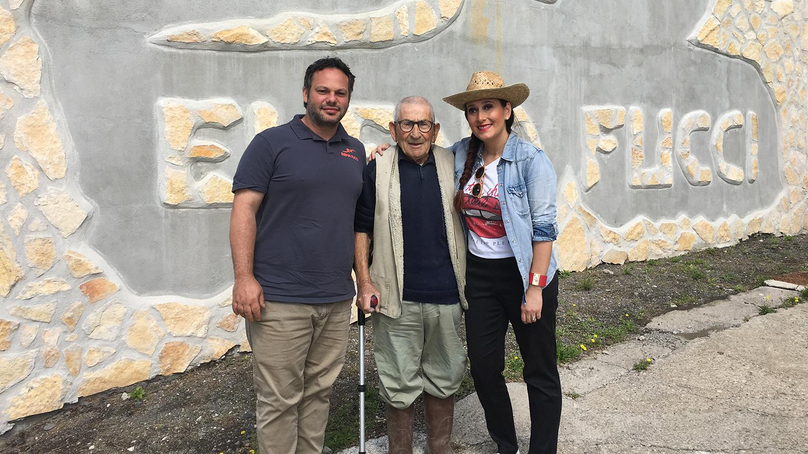 Winemaker Elena Fucci with her husband, Andrea Manzani (left), and grandfather Generoso at her