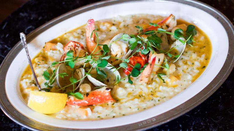 Chef Mark McCain's shellfish risotto works well with butternut squash in winter months, shown here, but this summer, opt for greens like English peas and baby spinach.