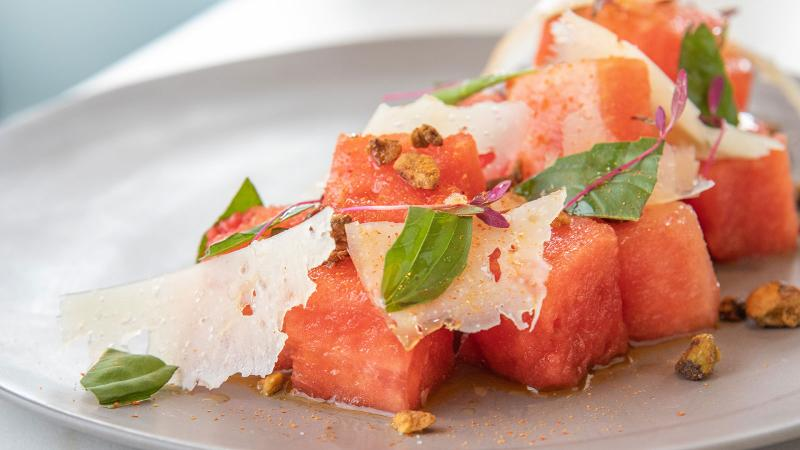 The juicy watermelon salad has spicy dried pepper, Pecorino Romano cheese, fresh mint and candied pistachios.