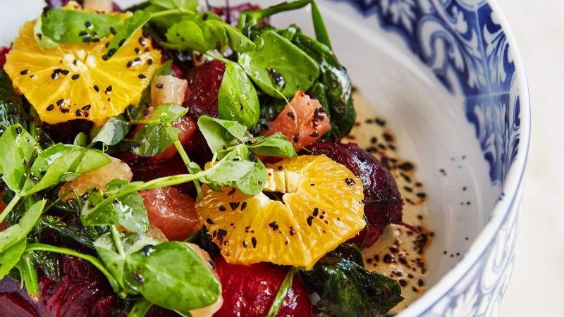 A spiced Chardonnay vinaigrette and nigella seeds dress a salad of roasted beets, pomelos and oranges.