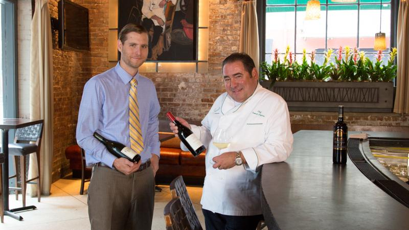 Ray Gumpert (L) shares Emeril Lagasse's passion for wine.