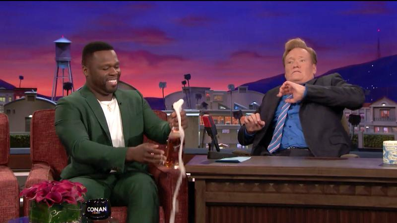 Get spritz or die tryin': 50 Cent pops a bottle without safety goggles.