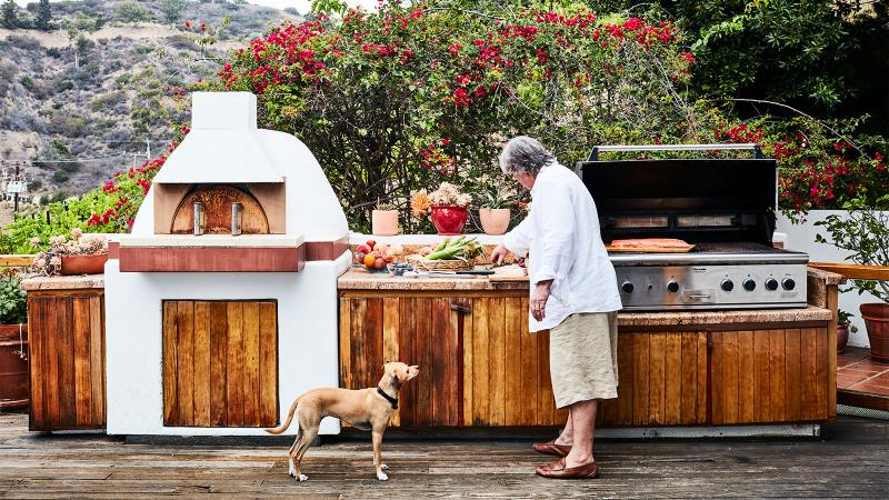 With rich Douglas fir appointments and a plaster-encased EarthStone pizza oven, the outdoor kitchen of Michael and Kim McCarty's main house is the nexus of many a patio party.