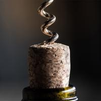 Cut off the top part of the capsule before inserting the corkscrew near the center of the cork.