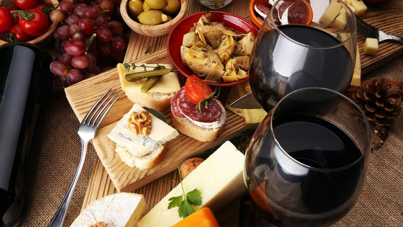 Image for an article: It's unclear if certain parts of the Mediterranean diet confer health benefits, or the combination of foods and wine.