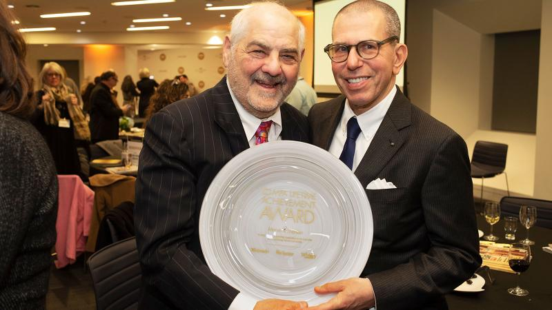 Marvin R. Shanken, left, accepted the award from Jonathan Newhouse, chairman of Condé Nast International.