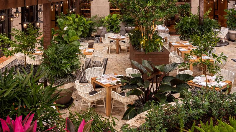 Isabelle's Grill Room & Garden features a lush outdoor terrace.