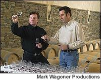 At his North Carolina winery, Richard Childress (left) tastes through samples with winemaker Mark Friszolowski.