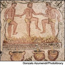 A third-century Roman mosaic, in the House of the Amphitheater in Mérida, Spain, depicts three men jauntily crushing wine grapes by foot.