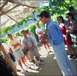 Visitors listen intently during a guided tour at the Robert Mondavi Winery.