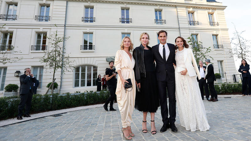 From left: Kate Moss, Uma Thurman, Roger Federer and Natalie Portman, probably minutes away from drinking some Champagne