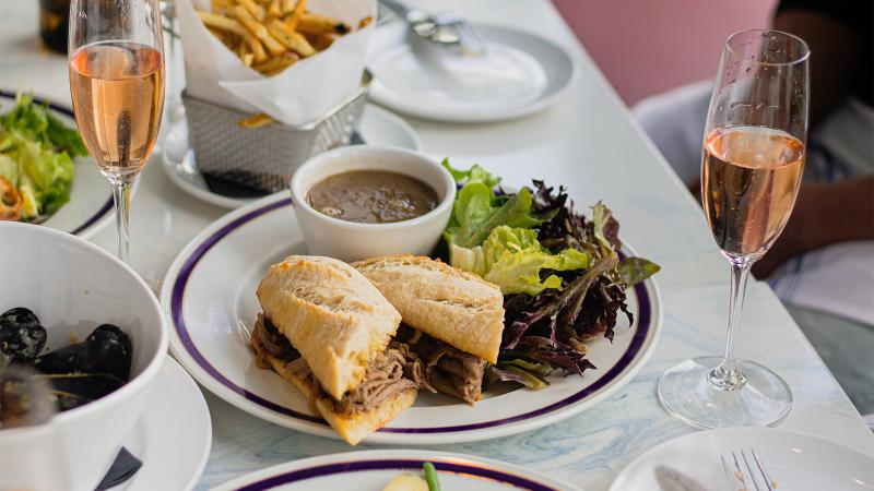 Little Frenchie's French dip sandwich with roast beef, onion confit, aioli and aged comté