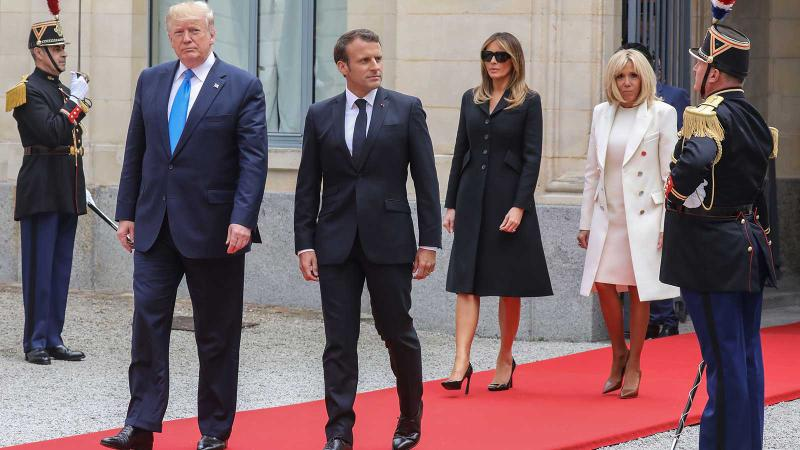 U.S. President Donald Trump, French President Emmanuel Macron, First Lady Melania Trump and Brigitte Macron met in June in Normandy to commemorate D-Day.