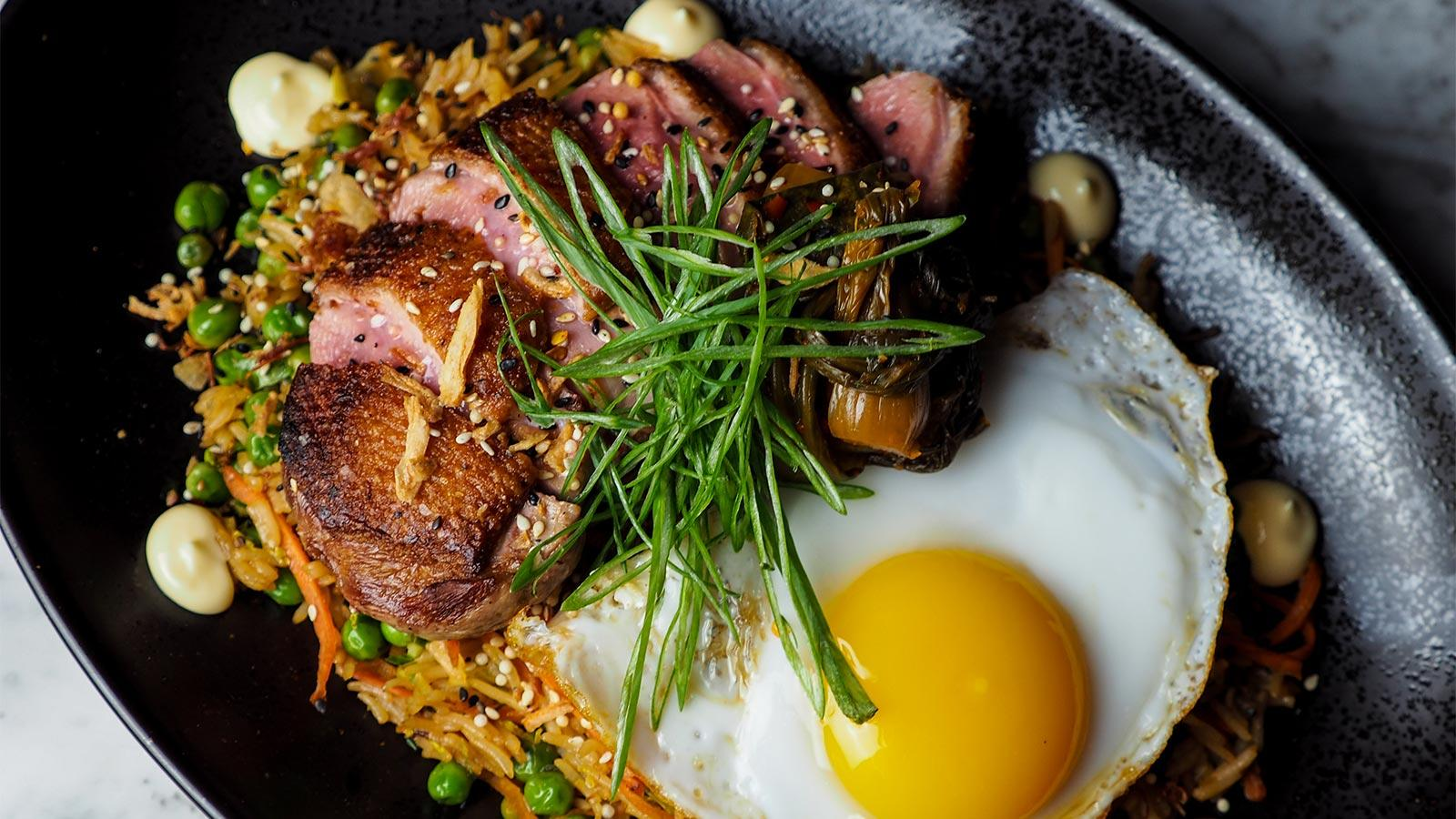 Duck breast with soy, fried rice and kimchi