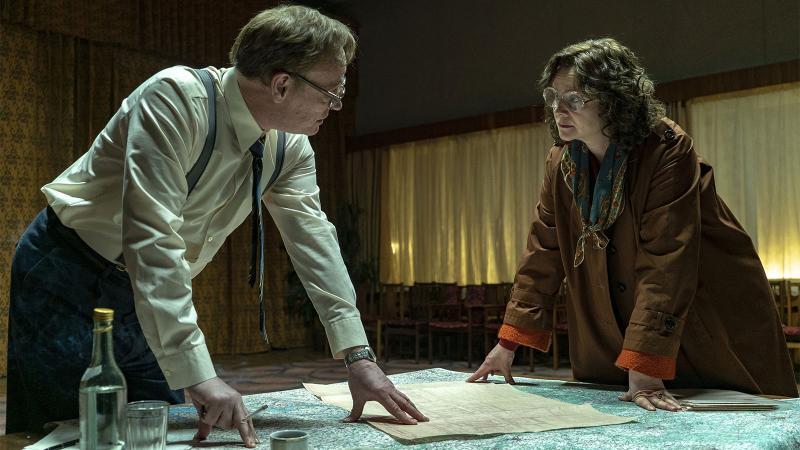 Valery Legasov and Ulana Khomyuk (Jared Harris and Emily Watson) drinking the previous batch of Chernobyl vodka in HBO's 'Chernobyl.'