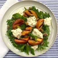 Celebrate peak peach season with this bright and balanced salad.
