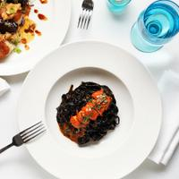 Nerai's poached lobster with squid-ink linguini in metaxa bisque