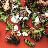 Spicy masala chicken wings on a red background