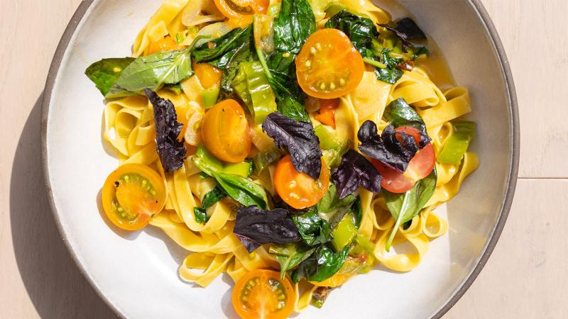 Electric Lemon's chickpea pasta, with sungold tomatoes, blistered shishito peppers and basil