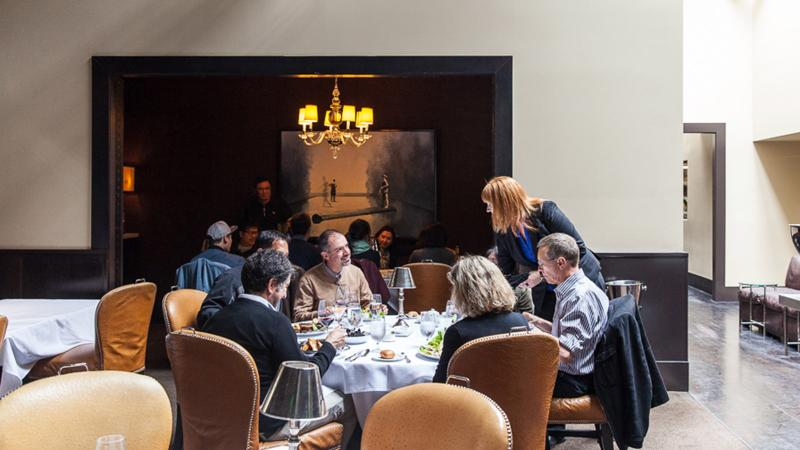 Patrons enjoy a meal the old-fashioned way at Spruce in San Francisco.