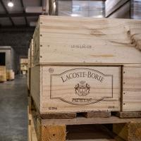 Crates of Bordeaux await shipping at a French warehouse; the new tariffs will mean more expensive wines.