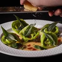 Sfoglina's spinach tortellini, filled with barbecue pork and topped with sage and Pecorino