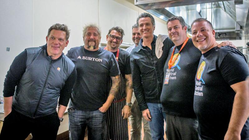 Their powers combined! From left: Tyler Florence, Guy Fieri, Chris Cosentino and other WCK chefs with California Gov. Gavin Newsom (dish rag on shoulder)