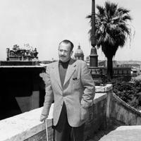 Of ice and men: John Steinbeck in 1964 (left); Steinbeck's engraved, silver-plated wine cooler