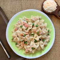 Salty smoked salmon and fresh bursts of peas brighten this pasta dish.