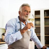Older man enjoying wine