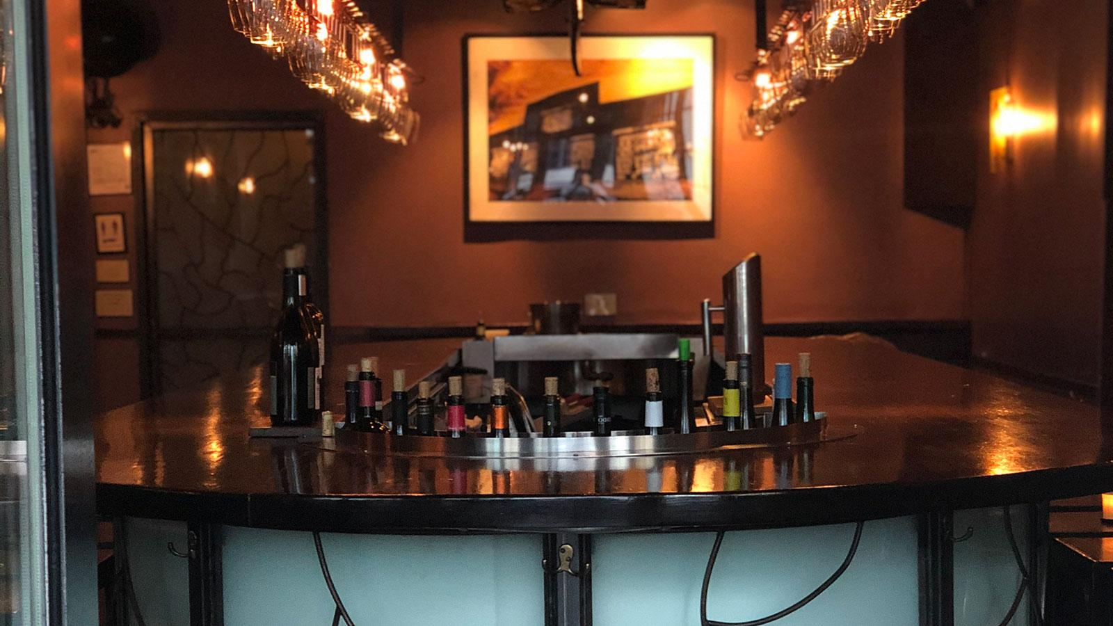 Bar with bottles behind it