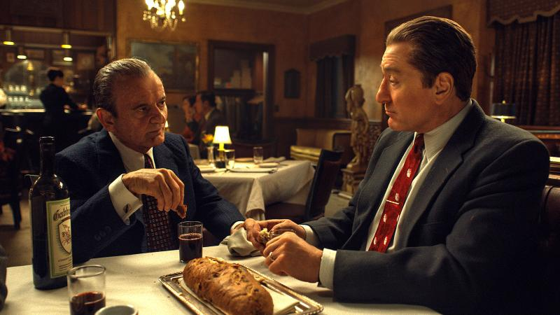 The good grape juice: Joe Pesci and Robert De Niro convene over Gabbiano Chianti in a scene in The Irishman.
