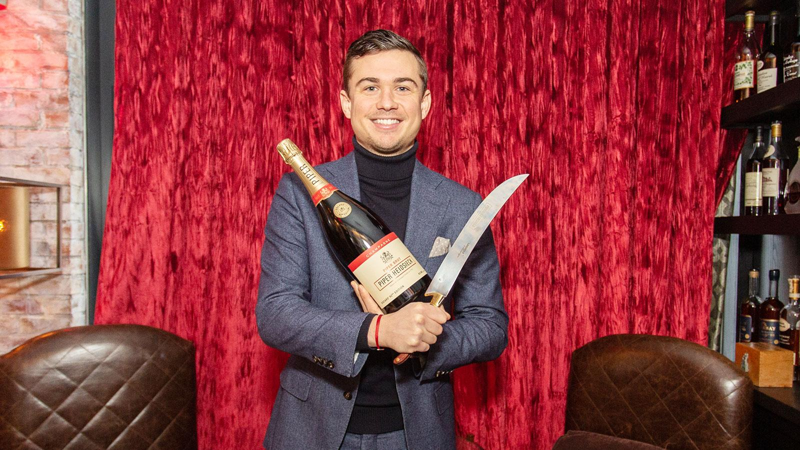 Piper-Heidsieck's Jonathan Boulangeat with the retro bottle and saber