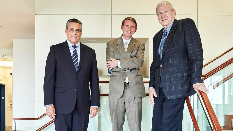 From left: attorneys Joel Deutsch, Stan Gibson and Bruce Jeffer