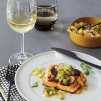 Plate of grilled sea trout with green-tomato salsa and a glass of white wine