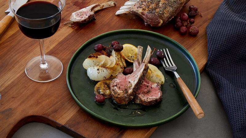 These special-occasion lamb chops with roasted grapes and vegetables are straightforward to prepare but impressive on impact.