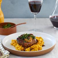 This meaty classic of Milanese cuisine gets a hit of color and delicate florality from saffron risotto, with concentrated bone marrow sauce, plus a bracing gremolata.